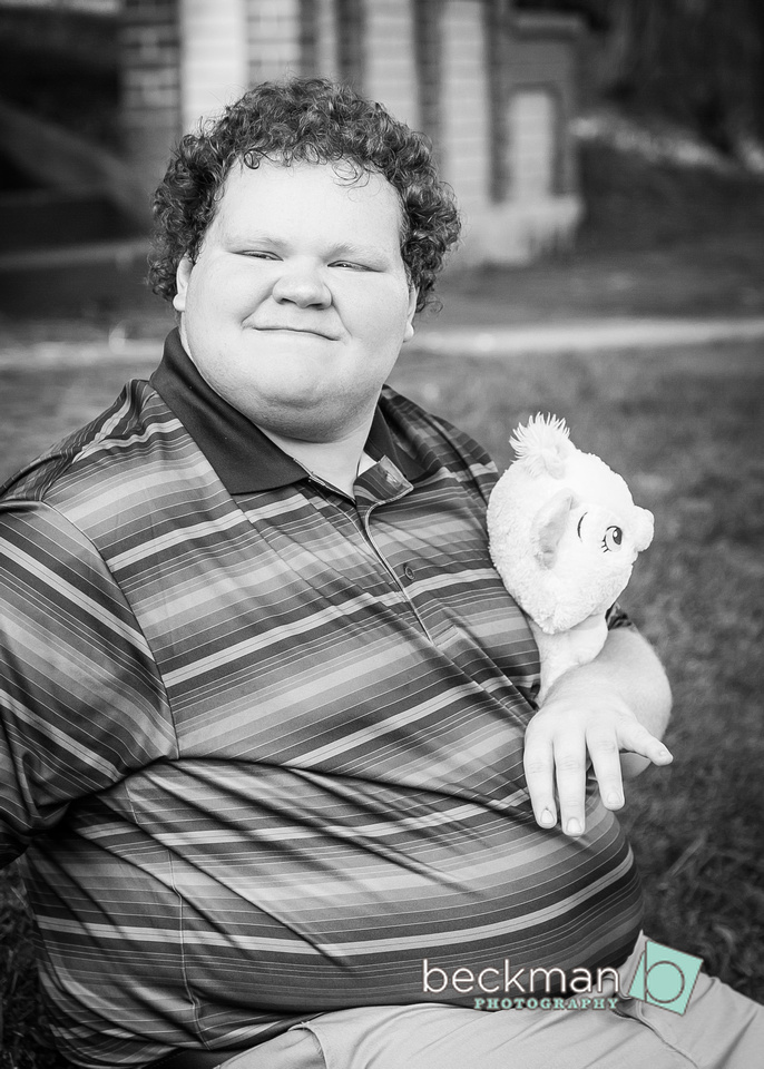 Nathan has autism and posed with his favorite stuffed cat for this picture.